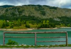 Wooden barrier on the lake royalty free stock photos