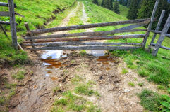 Wooden barrier on mountain road Stock Photos