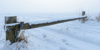 Wooden barrier over closed snowy road Stock Images