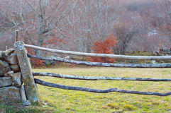 Wooden barrier in a rural field Stock Photos