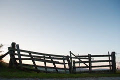 Wooden barrier in a rural field Royalty Free Stock Photos