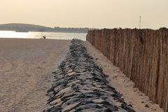 WOODEN BARRIER  ON SEA SHORE stock photo