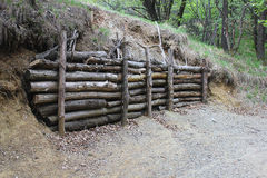 Wooden barrier with trunks Royalty Free Stock Photography