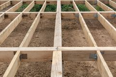 The wooden base for a country house. The wooden base for a house royalty free stock photography