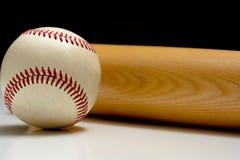 Wooden baseball bat and a ball Royalty Free Stock Image