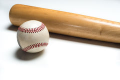 Wooden baseball bat and ball on white Royalty Free Stock Photo