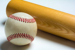 Wooden baseball bat and ball on white Stock Photography