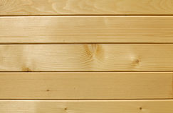 Wooden baseboard panelling background. Trimmed wooden baseboard panelling background with horizontal strips Royalty Free Stock Photography