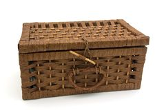 Wooden basket. A decorative wooden basket in front of a white background Stock Images