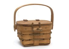 Wooden basket. Wooden woven basket with lid and leather peg latch - leather hinges on white background stock photos