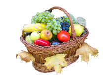 Wooden basket with autumn harvest fruit vegetables Stock Photo