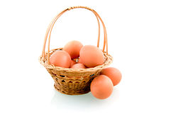 Wooden basket with chicken eggs. Isolated on white background Royalty Free Stock Photos