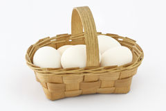Wooden basket with eggs Royalty Free Stock Images