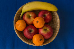 Wooden basket filled with healthy and fresh fruits Stock Images