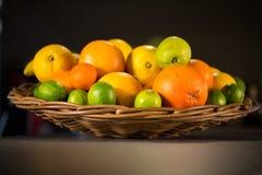 Wooden basket full of fresh fruits for lemonade Royalty Free Stock Photos
