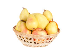 Wooden basket full of fruits. On a white background Stock Photo