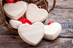 Wooden basket full of hearts Royalty Free Stock Photos
