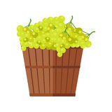 Wooden Basket with Grapes. White Wine. Royalty Free Stock Photography