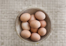 Wooden basket with organic eggs. Royalty Free Stock Images