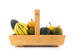 Wooden basket ornamental gourds Royalty Free Stock Photo