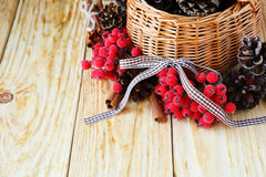 Wooden basket with pine cones Royalty Free Stock Images