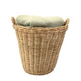 Wooden basket with stack of apparels isolated on white Stock Photo