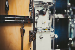Wooden bass drum detail musical instrument. Wooden bass drum detail with different drums aligned in store, selective focus Royalty Free Stock Photography