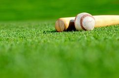 Wooden bat and baseball Royalty Free Stock Images