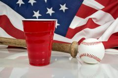 Red party cup with baseball and bat