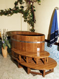 Wooden bath. Ing tub in the bath Stock Photography