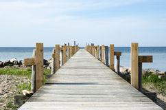 Wooden bath pier by the coast Royalty Free Stock Images
