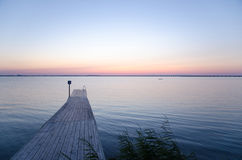 Wooden bath pier at soft colored sunset Royalty Free Stock Photo