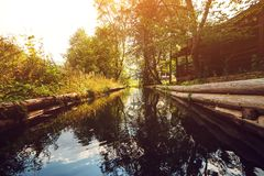 Wooden bathhouse near pond in evening. Forest landskype. stock photos