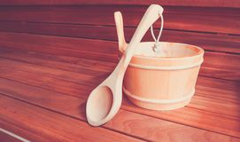 Wooden Bathhouse with scoop and tub tools close up. Wooden sauna stock photography