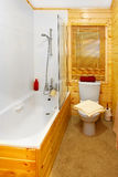 Wooden bathroom Stock Images
