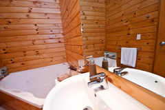 Wooden bathroom interior in mountain lodge Royalty Free Stock Image