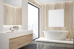 Wooden bathroom interior, tub, poster side. Modern bathroom interior with wooden walls, a black floor, a sink and a white tub with a poster hanging above it. A royalty free illustration