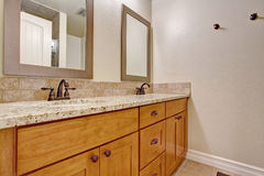 Wooden bathroom vanity cabinet with granite top Stock Photo