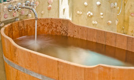 Wooden bathtub Royalty Free Stock Image