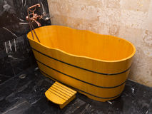 Wooden bathtub in a bathroom Stock Photos