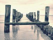 Wooden batten bridge juts out into expanse of sea. The famous tourist attraction. Wooden batten bridge juts out into the expanse of the sea. The famous tourist royalty free stock photo