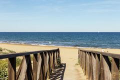 Wooden beach access in Alicante.  Spain Royalty Free Stock Image
