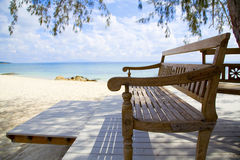 Wooden beach bench and the sea Stock Photography