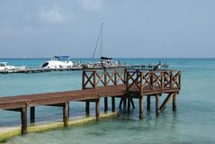Wooden beach bridge on the Mexican gulf in Cancun, Mexico Royalty Free Stock Photo