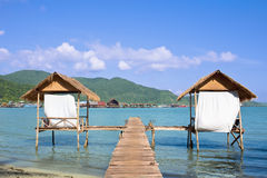 Wooden beach bungalows over water Royalty Free Stock Photos