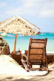 Wooden beach chair on exotic beach Stock Images