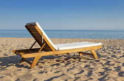 Wooden beach chair at ocean front Stock Photo