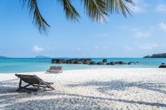 Wooden beach chair under coconut tree on beautiful beach at kohmak Island Royalty Free Stock Photo