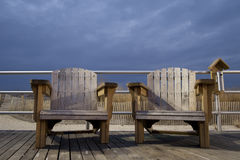 Wooden Beach Chairs. On the boardwalk Stock Photography
