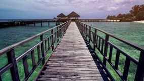 Wooden Beach Dock or Wooden Pier at Beautiful Tropical Beach. Tropical Beach is Beautiful Exotic Travel Destination in The World Royalty Free Stock Photo